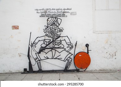 GEORGETOW, PENANG, MALAYSIA - March 26, 2015: Wire steel rod wire art around Penang George town area heritage zone.Sculpture  by local artist.