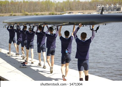 The Georgetown 8-man heavyweight crew prepares to set their boat in the water