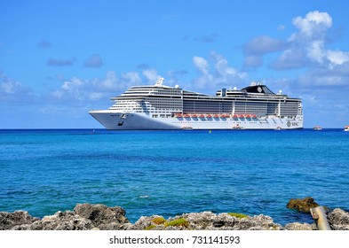 Georgetown, Grand Cayman - September 19, 2017:Transatlantico MSC Divina anchored in the clear and turquoise waters of the Caribbean Sea. Every year the city receives thousands of tourist.