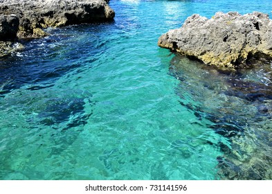 Georgetown, Grand Cayman - September 19, 2017: The clear and turquoise waters of the Caribbean Sea. Every year the city receives thousands of tourist.