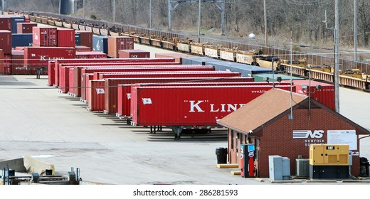 GEORGETOWN, KY-MAY, 2015:  Norfolk Southern rail inter modal yard adjacent to the Toyota assembly plant. Containers are in the front of the image while the rail cars are in the rear.