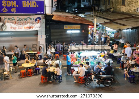Georgetown, Malaysia - 03 August, 2014: The crowd of people dining at the street food stalls on Lebuh Chulia in historic part of Chinatown on 03 August 2014, Georgetown, Malaysia.