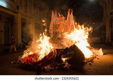Georgetown, Malaysia - August 2018 - The 'Dai She Ye' paper effigy is burnt on the last day of the prayer session along with hell notes in Penang.
