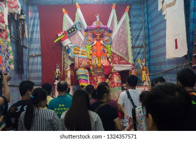 Georgetown, Malaysia - August 2018 - Worshippers pray to the 'Dai She Ye' paper effigy in Penang during the Hungry Ghost Festival