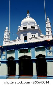 Georgetown, Malaysia - January 12, 2008: Nagore Durgha Sheriff Hindu Temple with twin minarets and dome on Jalan Chulia in Little India