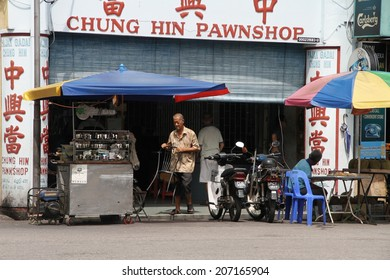GEORGETOWN, MAYLASIA - MAY 30: A typical Chinese pawn shop in Gat Lebuh Chulia in Georgetown, Malaysia on the 30th May, 2014.