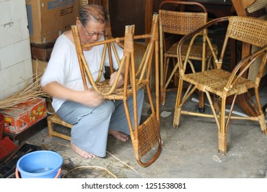 GEORGETOWN, PENANG - AUGUST 8, 2013:  Handmade crafts of a craftsman working traditional rattan chair in Georgetown.