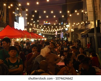 GEORGETOWN, PENANG, MALAYSIA, APRIL 15th 2018 - The crowds enjoying their dinner along the street during food festival in Penang, Malaysia.
