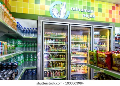 """Georgetown, Penang, Malaysia. April 19, 2017. Various food and drink products stocked on shelves in a convenience store. """"Minuman sejuk"""" is Cold Drinks, """"Barangan Runcit"""" is Grocery Items."""