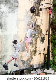 "Georgetown, Penang, Malaysia - April 23: ""Children Playing Basketball"" street art mural by local artist Louis Gan in George Town, Penang, Malaysia."