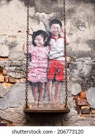 "Georgetown, Penang, Malaysia - April 23: ""Children on the Swing"" street art mural by local artist Louis Gan in George Town, Penang, Malaysia."