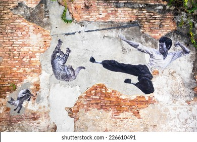 """Georgetown, Penang, Malaysia - April 23: Street art mural """"The Real Bruce Lee Would Never Do This"""" in George Town, Penang, Malaysia."""