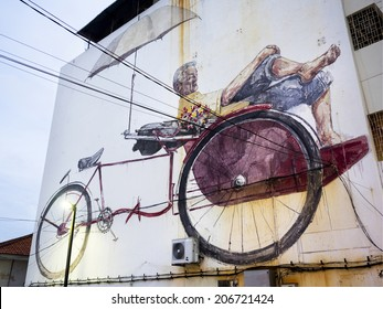 "Georgetown, Penang, Malaysia - April 24: Street art mural ""The Awaiting Trishaw Paddler"" painted by Lithuanian artist Ernest Zacharevic in George Town, Penang, Malaysia."