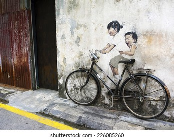 "Georgetown, Penang, Malaysia - April 24: ""Little Children on a Bicycle"" street art mural by Lithuanian artist Ernest Zacharevic in George Town, Penang, Malaysia."