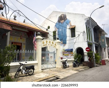 """Georgetown, Penang, Malaysia - April 25: """"Little Girl in Blue"""" street art mural by Lithuanian artist Ernest Zacharevic in George Town, Penang, Malaysia."""