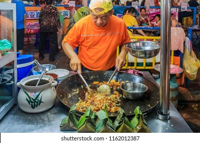 Georgetown, Penang, Malaysia - August 17, 2013: Street food vendor or hawker stall in Penang Georgetown UNESCO heritage zone