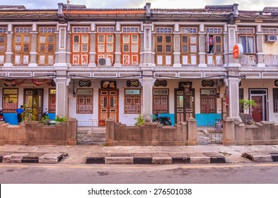 Georgetown, Penang, Malaysia - August 17, 2013: Traditional Malaysian colonial houses in disrepair on a street in Georgetown