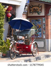 Georgetown, Penang, Malaysia. Circa 2016. A Trishaw outside a temple in Georgetown.