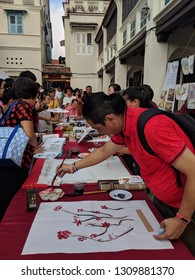 Georgetown, Penang / Malaysia - Feb 9, 2019: calligraphy demonstration during the Georgetown Chinese new year festival in the unesco world heritage site