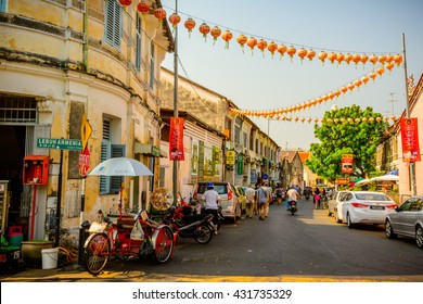GEORGETOWN, PENANG, MALAYSIA - FEBRUARY 15, 2015: People walk at Lebuh Armenia, one of the main streets in historical Georgetown, Penang, Malaysia