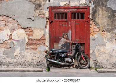 """Georgetown, Penang, Malaysia - February 19, 2015: """"Little Boy With Pet Dinosaur"""" street art on wall by Lithuanian artist Ernest Zacharevic in George Town, Penang, Malaysia."""