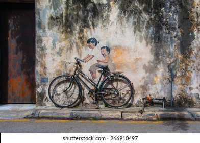 "Georgetown, Penang, Malaysia - February 19, 2015: ""Little Children on a Bicycle"" street art on wall by Lithuanian artist Ernest Zacharevic in George Town, Penang, Malaysia."