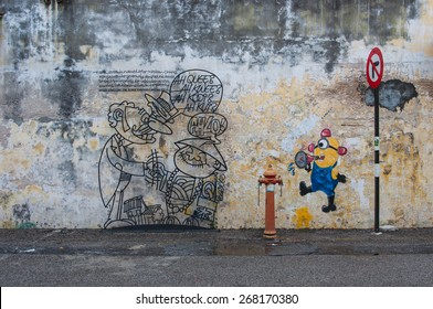 Georgetown, Penang, Malaysia - February 19, 2015: Wire art and mural at Victoria street, the other is a minion from the movie, Despicable Me in George Town, Penang, Malaysia.