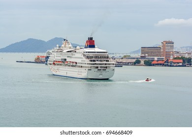 GEORGETOWN, PENANG, MALAYSIA - January 02, 2017: Cruise passenger ship 'Superstar Gemini' arrives at the Georgetown harbor. The ship was built in 1992 and owned and operated by Star Cruises.