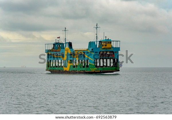 GEORGETOWN, PENANG, MALAYSIA - January 02, 2017: Ferry boat of Penang Ferry Service, oldest ferryboat service in Malaysia, transport passenger and vehicle from another place to Georgetown, Malaysia.