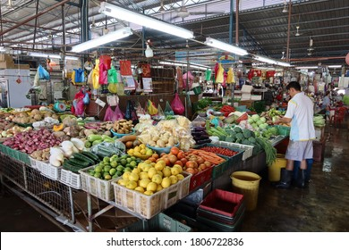 Georgetown, Penang, Malaysia, January 4, 2020: A man orders his wares at a fruit stall at Pasar Lebuh Cecil Market in Georgetown, Malaysia.
