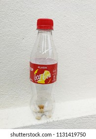 """Georgetown penang Malaysia. July 11, 2018. Empty Coca cola classic with the label featuring the Fifa Russia 2018 World Cup. Classic written in the Malay word """"Klasik"""" for the Malaysian market."""