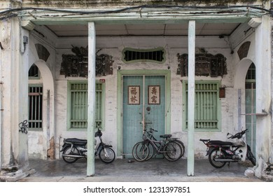 Georgetown, Penang, Malaysia - July 30, 2018; House with bikes and scooters in the street of Georgetown capital of the island Penang, polulair with tourist