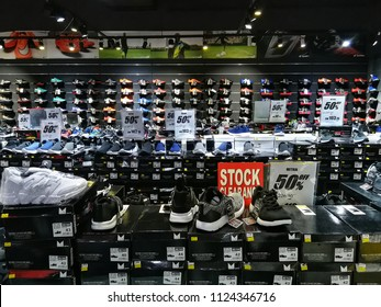 Georgetown penang Malaysia. June 23, 2018. Boxes of overstocked sneakers and sports shoes on sale with discount price in a sporting goods store.
