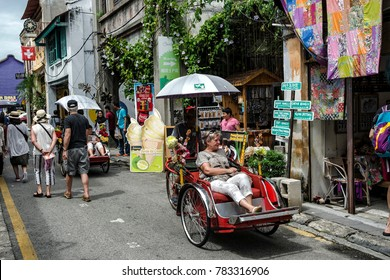 Georgetown, Penang, Malaysia - November 25, 2017: Tourists at Armenian Street, a heritage road with a lot of tourist attractions, Penang, Malaysia