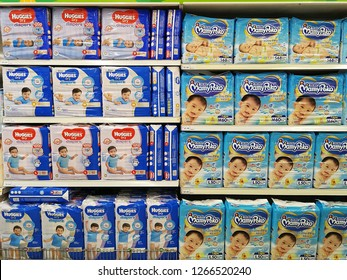 Georgetown, Penang, Malaysia. November 28, 2018. Major competitive diaper brands of Huggies and Mamypoko placed side by side at the Tesco hypermarket.