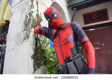Georgetown, Penang, Malaysia – Oct 18, 2018 :  Unidentified man does cosplay of Deadpool in Lebuh Armenian street, Penang.
