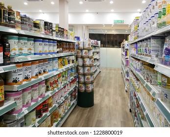 Georgetown Penang Malaysia. October 15, 2018. Various tins and containers of supplement powder and baby milk formula on the shelves of the Georgetown pharmacy.