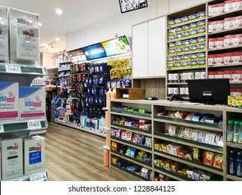 Georgetown Penang Malaysia. October 15, 2018. View of the payment counter area surrounded by various selections of products in the Georgetown pharmacy such as candies, cough drops, cooling drinks.
