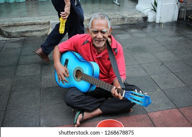 Georgetown, Penang - November 24, 2018 : An oldman presented a busking using guitar at the Penang Street Art