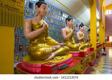 Georgetown, Penang/Malaysia - 09.10.2017: Buddha statue and Columbarium in the  Thai buddhist Temple Wat Chayamangkalaram