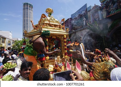 GEORGETOWN, PENANG/MALAYSIA - CIRCA FEB 2017: Priest of gold chariot carry fire in front Sri Kamatchi Amman Temple during Thaipusam celebration.
