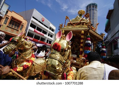 GEORGETOWN, PENANG/MALAYSIA - CIRCA FEB 2017: Golden statue of horse with colorful flowers of the golden chariot during procession to celebrate Thaipusam.