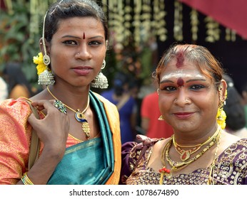 GEORGETOWN, PENANG/MALAYSIA - JAN 30, 2018: Dressed-up couple of Malaysian Indian gender queer street workers (Hijra people) poses for the camera during Thaipusam festival, on Jan 30, 2018.