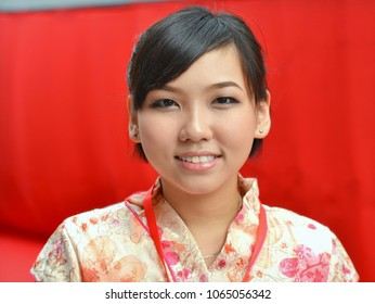 GEORGETOWN, PENANG/MALAYSIA - June 16, 2013: Young Malaysian Chinese woman wears a traditional Chinese dress (cheongsam) and poses for the camera during Chinese New Year, on June 16, 2013.