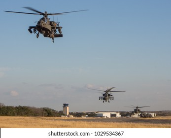 Georgetown, TX/USA - September 25 2010: Boeing AH-64 Apache Helicopters stop to refuel.