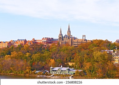 Georgetown University buildings in fall along the Potomac River. Urban scenic panorama in autumn with buildings and recreational facilities.