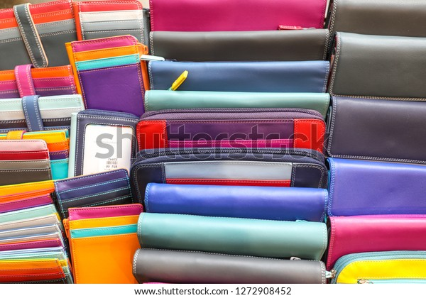 Georgetown, Washington, DC - November 1, 2018: Colorful wallets are for sale at a public street fair.