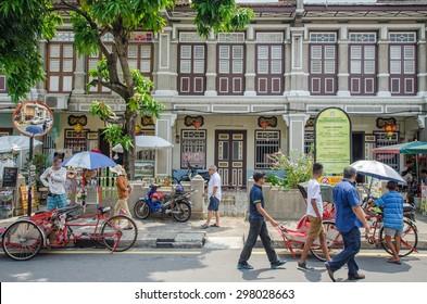 Georgetown,Penang - July 17,2015 : People can seen walking and exploring around the street art in Georgetown, Penang