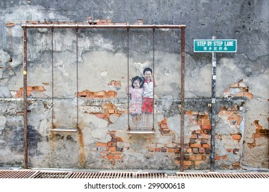"Georgetown,Penang - July 18,2015 : ""Children on the swing"" painted by Louis Gan at Chulia street in Georgetown, Penang"
