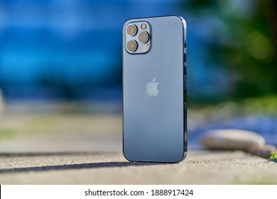 Georgia, Batumi - 4 January, 2020. The newest Apple iPhone 12 pacific blue color with 3 phone camera lenses of 2020 release